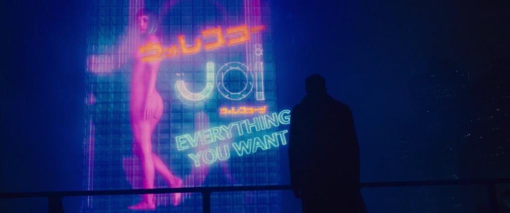 Joi (Ana de Armas): tudo o que você quer ; em qualquer lugar que você queira; tudo o que você queira ouvir.